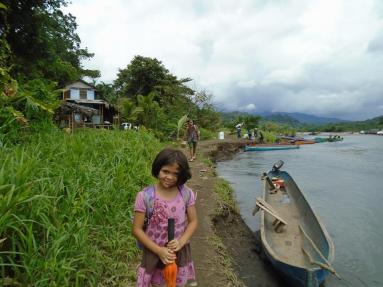 indigenous girl by boat
